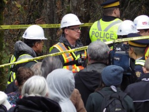 Kinder Morgan employees, contractors, RCMP, protestors, and media in court ordered enclosed area